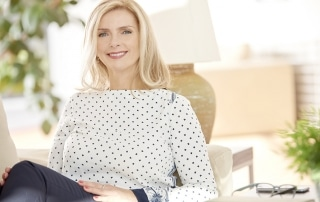 Mature woman feeling happy at home