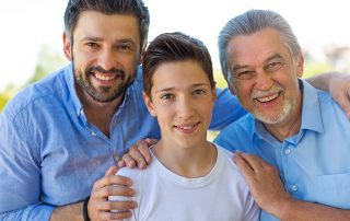 Young Boy bonding with father and grandfather