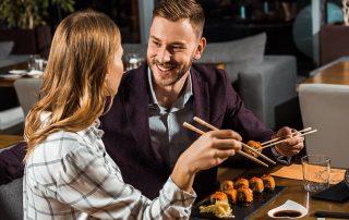 couple enjoying sushi together