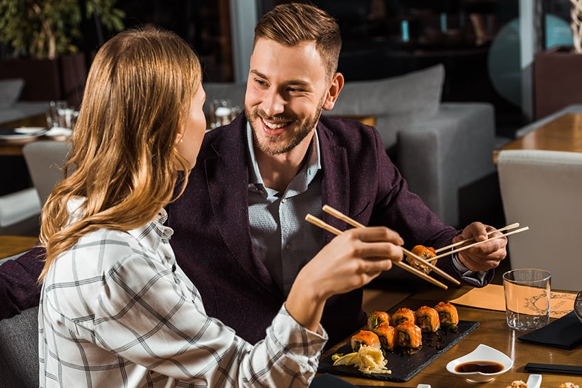 lovely couple enjoying a sushi meal together