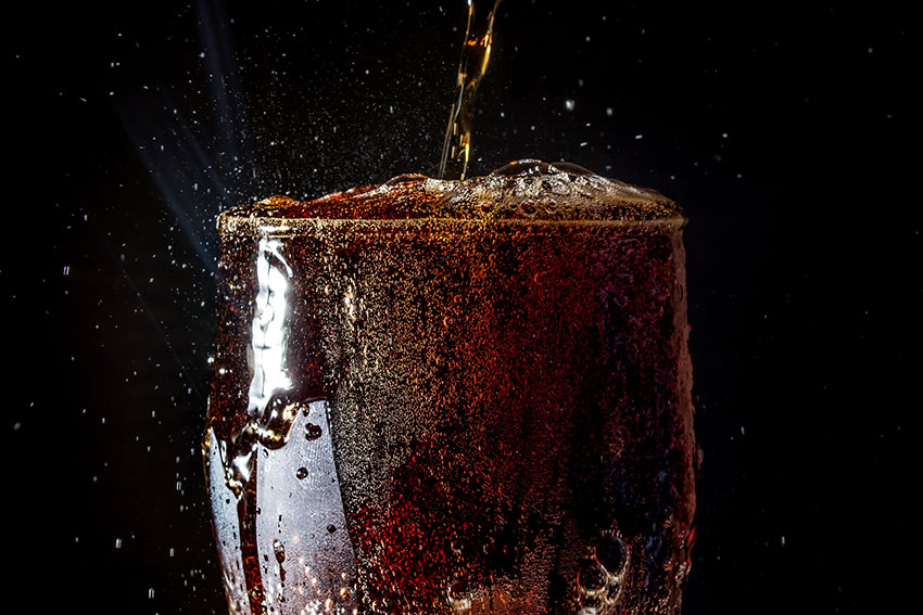 fizzy glass of ice cold coca-cola