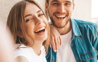 young couple showing laughing with each other